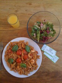 spicy seafood pasta with king prawns, cherry tomatos, wholewheat penne, crushed chillies and fresh basil leaves